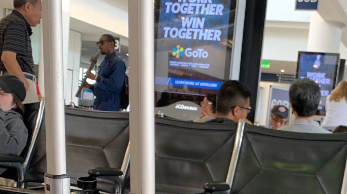 Andre 3000 Seen Casually Playing the Flute at the Airport